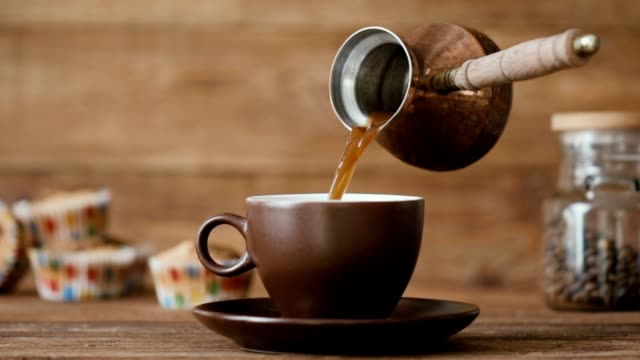 Cinemagraph - Pouring coffee into a cup . Nobody. Cinemagraph - Pouring coffee into a cup . Nobody. Motion Photo. mug stock videos & royalty-free footage