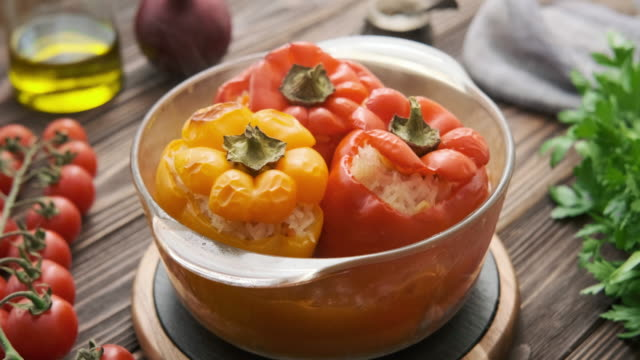 Cinemagraph - Stuffed peppers with rice. Cinemagraph - Stuffed peppers with rice. Motion Photo. stuffed stock videos & royalty-free footage