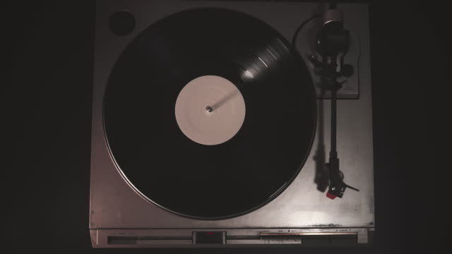 Cinemagraph vintage vinyl disc on music turntable record player