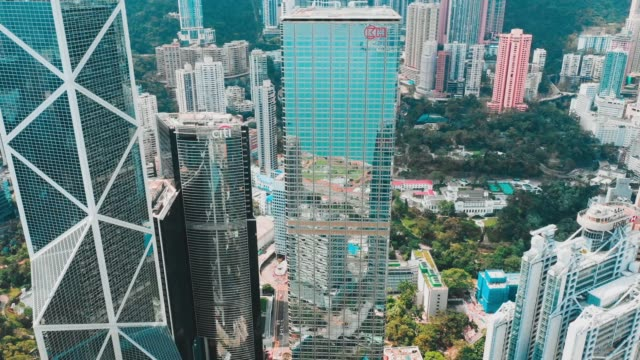 cinematic color graded aerial view fhd footage of hong kong city in sunrise - hong kong video stock e b–roll