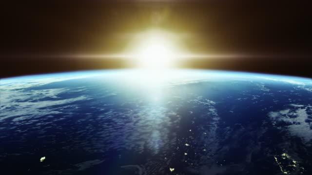 都市 - 宇宙から地球の映画のようなカラフルな日の出ライト 4 k - 地球点の映像素材/bロール