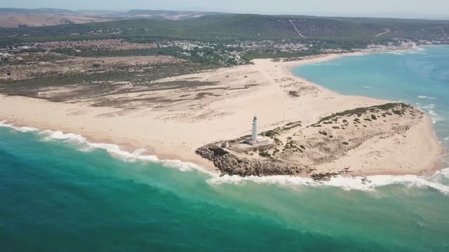 Cinematic drone point of view of Cape Trafalgar lighthouse, in ZAHORA - Cadiz Province , south-west of Spain