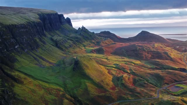 Cinematic flight over the Quiraing during sunrise on the eastern face of Meall na Suiramach, Isle of Sky Cinematic flight over the Quiraing during sunrise on the eastern face of Meall na Suiramach, Isle of Skye, Highland, Scotland, UK scotland stock videos & royalty-free footage