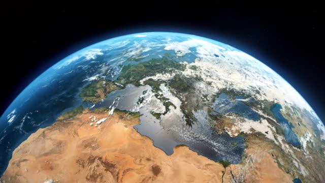vídeos de stock e filmes b-roll de cinematic realistic rotating earth in space - portugal map