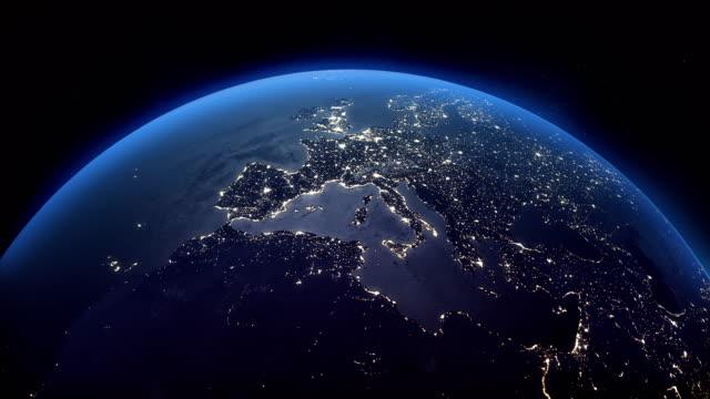 vídeos de stock e filmes b-roll de cinematic realistic rotating night earth in space - portugal map