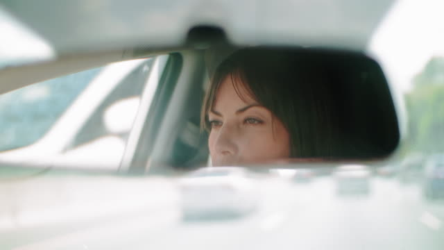 Cinematic shot of a pretty woman driving during the day. Cinematic shot of a pretty woman driving during the day. 4K Footage. image focus technique stock videos & royalty-free footage