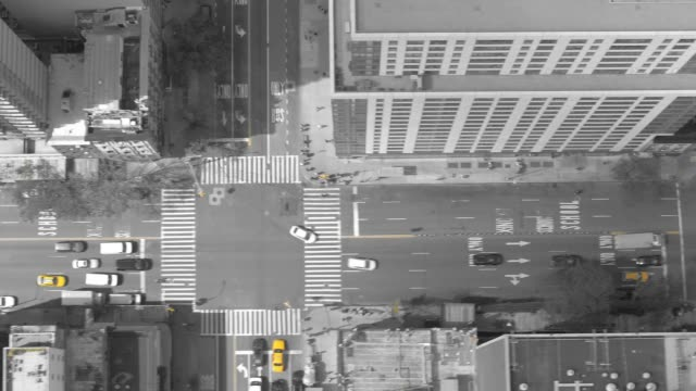 AERIAL: Cinematic shot of city traffic driving down busy metropolitan city road. video
