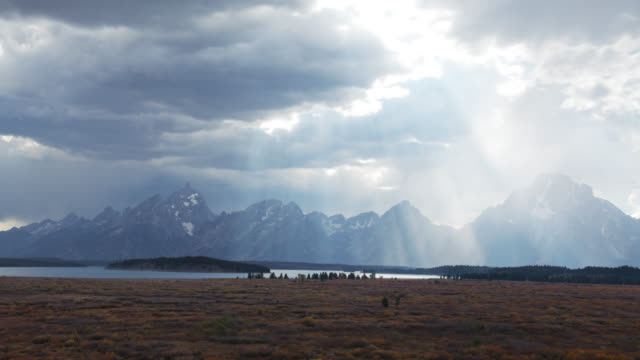 Cinematic Time-lapse of Rays of Light Passing Over Grand Tetons video