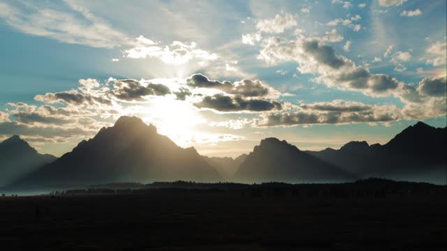 Cinematic Time-lapse of Sun Setting Behind MT. Moran Grand Tetons video