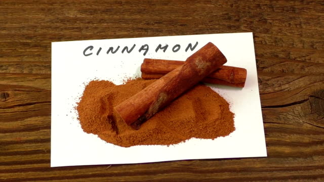 Cinnamon on an old wooden table video