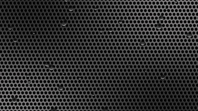 Circle perforated sheet metal with drops of water video