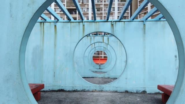 circle round spot at lok wah south estate in hong kong - vintage architecture stock videos & royalty-free footage