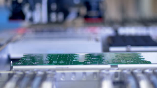 circuit board assembly, production line. 4k. - cavo componente elettrico video stock e b–roll