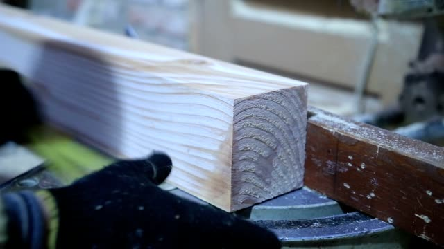Circular saw cutting wooden plank in workshop video