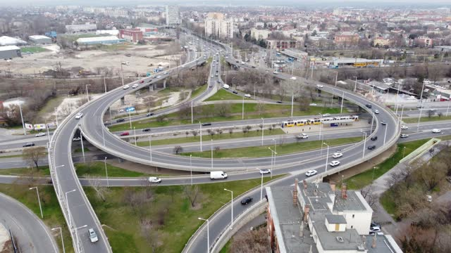 Circular Traffic Drone View Drone footage of Circular traffic on a Busy road inside a Metropolitan city hungary stock videos & royalty-free footage
