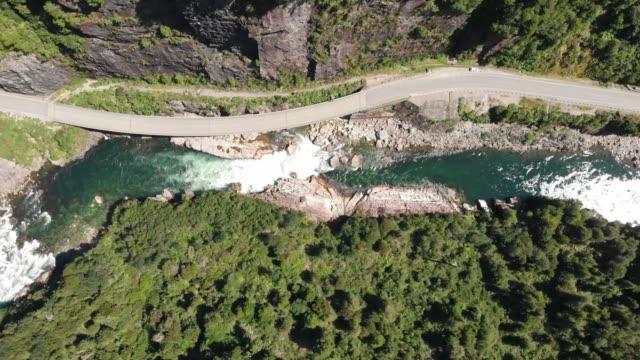 Cisnes river at Piedra El Gato in the chilean Patagonia Aerial view of Cisnes river, located next to Carretera Austral near to Puerto Cisnes in the Chilean Patagonia, southern Chile cliffs stock videos & royalty-free footage