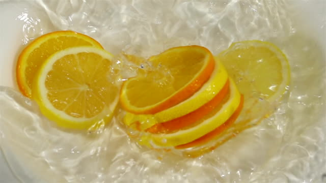 Citrus Fruit Slices Falling into Water. video
