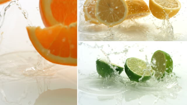 Citrus fruit splashing, slow motion video