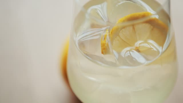 Citrus long drink served with ice Enjoy screwdriver long drink with vodka & fresh lemon juice in high crystal glass. margarita stock videos & royalty-free footage