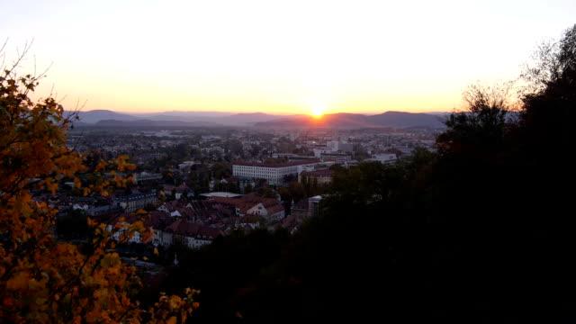 aerial: city at sunset - walking home sunset street bildbanksvideor och videomaterial från bakom kulisserna