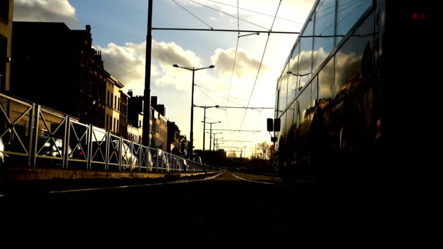 city bus rides on the railway tracks at sunset of the day video
