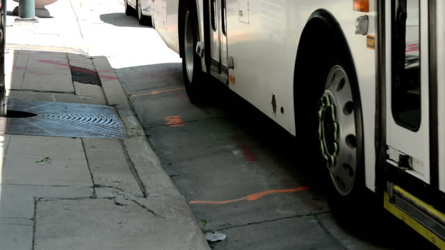 City bus Closeup of a city bus pulling up to a stop bus stock videos & royalty-free footage