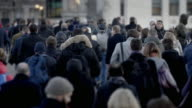istock City commuters walking on a cold morning. Rear view. 60fps SM. 1253989857