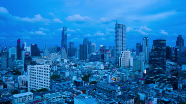 city day to night metropolis bangkok - monti urali video stock e b–roll