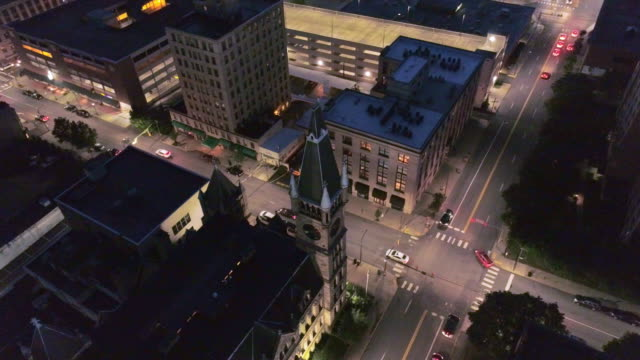 City Hall and Downtown District of Scranton in the night. Pennsylvania, USA. Aerial drone video with the descending and tilting up camera motion.