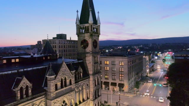 City Hall and Downtown District of Scranton in the night. Pennsylvania, USA. Aerial drone video with the descending camera motion.