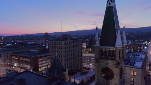 City Hall and Downtown District of Scranton in the night. Pennsylvania, USA. Aerial drone video with the forward camera motion.