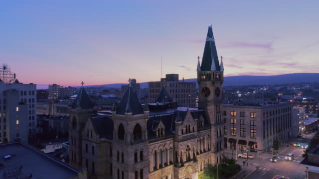 City Hall and Downtown District of Scranton in the night. Pennsylvania, USA. Aerial drone video with the backward and ascending camera motion.