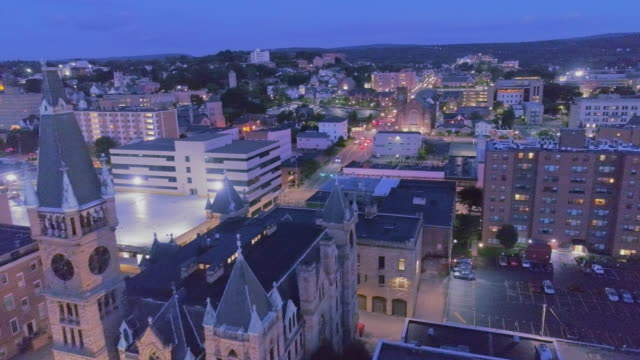 City Hall and Downtown District of Scranton in the night. Pennsylvania, USA. Aerial drone video with the backward camera motion.