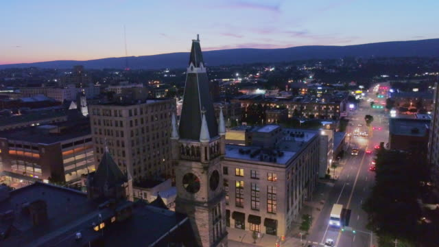 City Hall and Downtown District of Scranton in the night. Pennsylvania, USA. Aerial drone video with the slow descending camera motion.