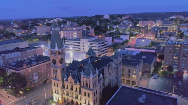City Hall and Downtown District of Scranton in the night. Pennsylvania, USA. Aerial drone video with the orbit camera motion.