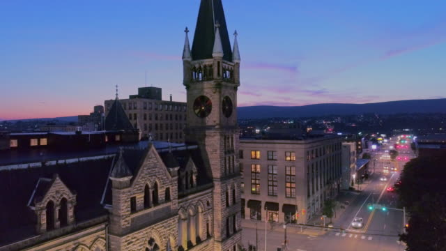 City Hall and Downtown District of Scranton in the night. Pennsylvania, USA. Aerial drone video with the ascending camera motion.