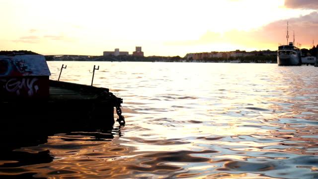City lake at sunset slow motion video