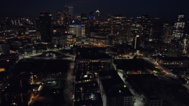 City Lights Aerial of Downtown Skyline Skyscraper Buildings Lit at Night video
