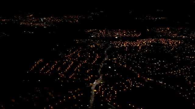 City lights from descending aircraft
