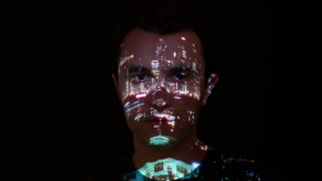 City lights projection on man's face Dubai city lights projection on man's face. projection stock videos & royalty-free footage
