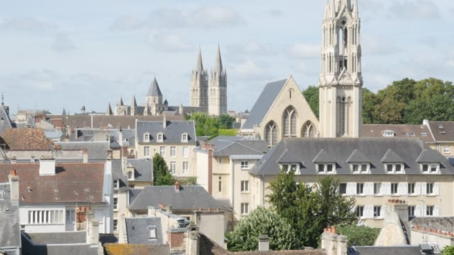 City of Caen in Northern Normandy capital of Calvados region 4K City of Caen in Northern Normandy capital of Calvados region 4K 2160p UltraHD slow tilt footage - Basse-Normandie city of Caen roofs and cathedral 4K 3840X2160 UHD video caen stock videos & royalty-free footage