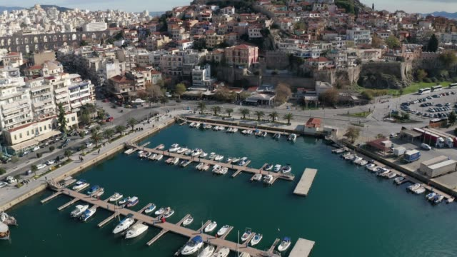 City of Kavala, Northern Greece Drone flight over the city of Kavala in northern Greece, new town, promenade and marina with boats aegean sea stock videos & royalty-free footage