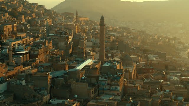 City of Mardin, in the Middle East in Mesopotamia - 4K Drone Footage Mardin is a city in southeastern Turkey. The capital of Mardin Province, it is known for the Artuqid architecture of its old city, and for its strategic location on a rocky hill near the Tigris River that rises steeply over the flat plains. The city has large populations of Arabs, Assyrians and Kurds.  Drone: Inspire 2 with Zenmuse X7, 6K Prores RAW mardin stock videos & royalty-free footage
