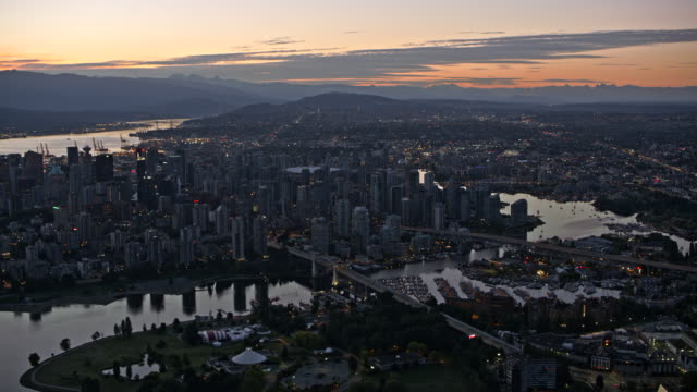 AERIAL City of Vancouver at sundown Aerial shot of the city of Vancouver, British Columbia at sundown. Shot in Canada. vancouver canada stock videos & royalty-free footage