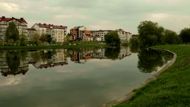 City on the river. Autumn evening. Smooth dolly shot.