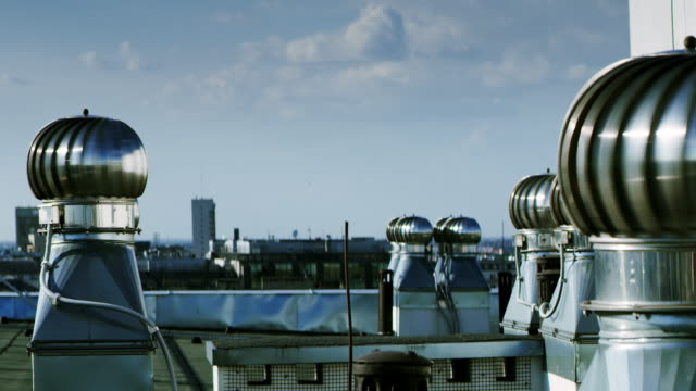 City panorama. Rooftop with metal chimneys