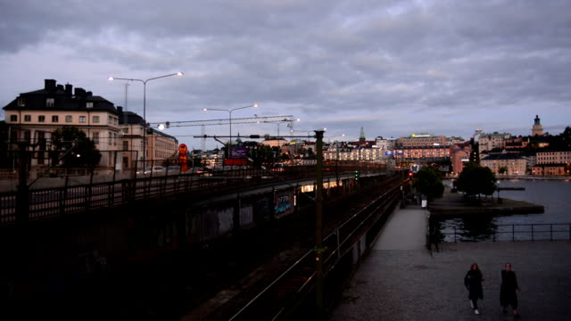 City Railroad in Stockholm Passenger train passing by at dusk. Stockholm, Sweden intercity stock videos & royalty-free footage