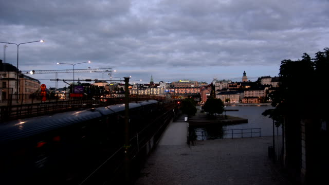 City Railway at Dusk Passenger train passing by at dusk. Stockholm, Sweden intercity stock videos & royalty-free footage