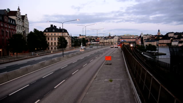City Road Traffic and Railroad Tracks City traffic and railroad tracks in Stockholm, Sweden intercity stock videos & royalty-free footage