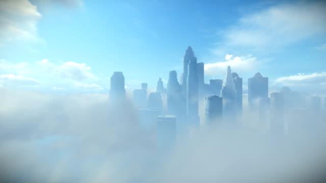 vídeos de stock e filmes b-roll de city skyline above clouds, dolly camera - above the clouds